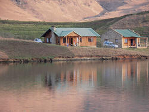 Crystal Waters Underberg. View of the accommodation with the trout dam in the forground.